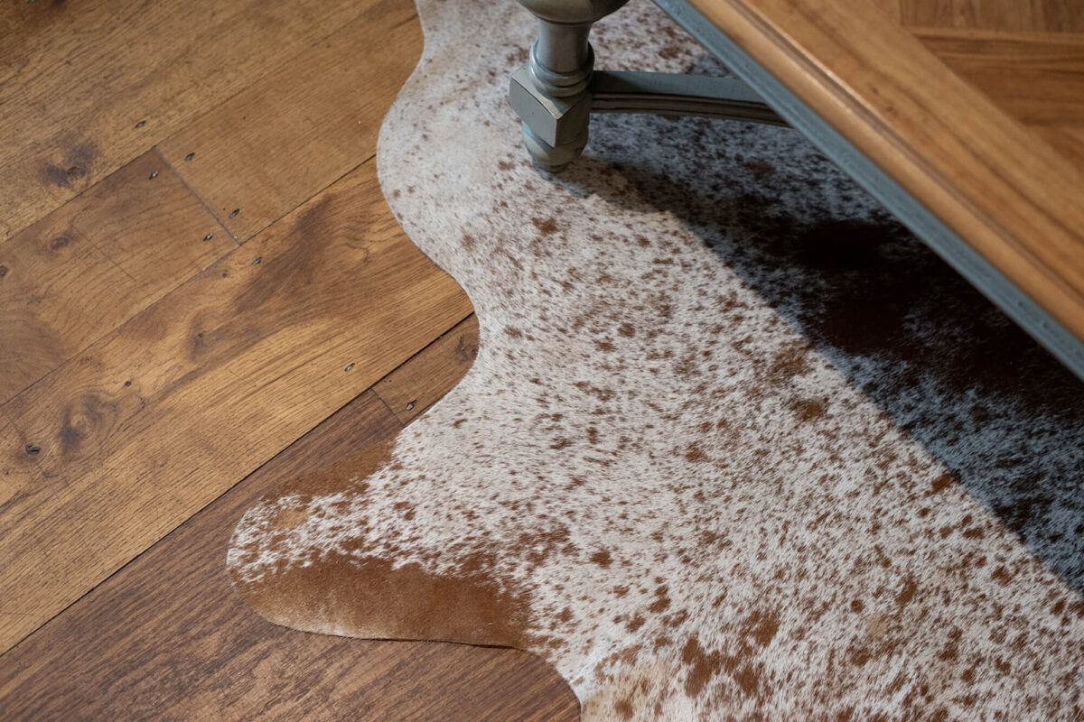 Character Oak Flooring with Cow Hide Rug