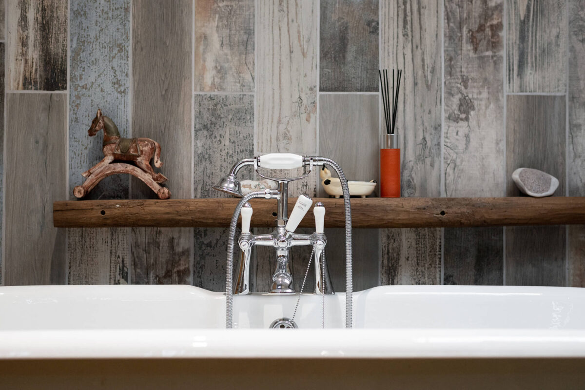 UK Hardwoods natural wood used as a shelf in the bathroom